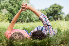 Cute couple holding hands in the park Stock Image