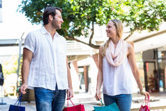 Cute couple holding shopping bags Royalty Free Stock Images