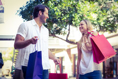 Cute couple holding shopping bags Stock Images