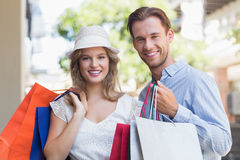 Cute couple holding shopping bags Stock Photo