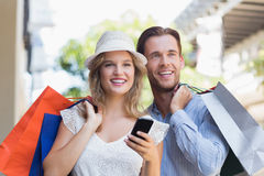 Cute couple holding shopping bags Stock Photography