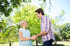 Cute couple holding their hands at the park Stock Photo