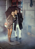 Cute couple with huge umbrella Royalty Free Stock Photos