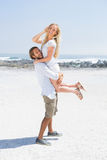 Cute couple hugging on the beach. On a sunny day Stock Photo