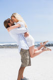 Cute couple hugging on the beach. On a sunny day Royalty Free Stock Photo