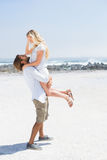Cute couple hugging on the beach. On a sunny day Stock Photography