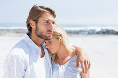 Cute couple hugging on the beach. On a sunny day Royalty Free Stock Image
