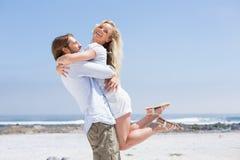 Cute couple hugging on the beach Stock Photo
