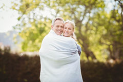 Cute couple hugging with a blanket around Stock Photos