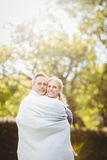 Cute couple hugging with a blanket around Stock Image
