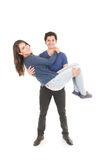 Cute couple hugging boy carrying girl Royalty Free Stock Photos