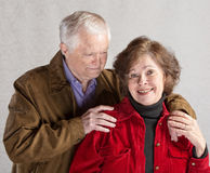 Cute Couple Hugging. Cute mature couple hugging over gray background stock image