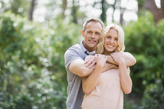 Cute couple hugging. Outside Stock Photos