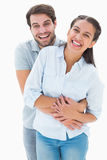 Cute couple hugging and smiling at camera Stock Images