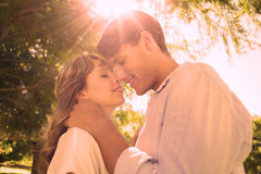 Cute couple hugging and smiling in the park Stock Images