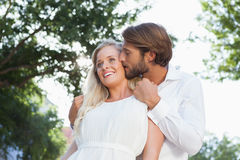 Cute couple hugging and smiling stock image