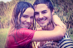Cute couple hugging under the rain Stock Images