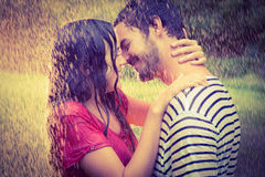 Cute couple hugging under the rain Royalty Free Stock Images
