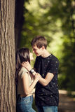 Cute couple kising in the park Stock Images