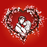 Cute couple kisses in a blossom heart Stock Photo