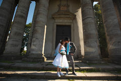 Cute couple kissing on background beautiful columns Stock Photography