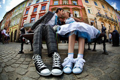 Cute couple kissing on the bench on background lviv royalty free stock photography