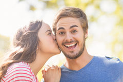 Cute couple kissing in the park Royalty Free Stock Images