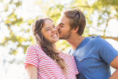 Cute couple kissing in the park Royalty Free Stock Photo