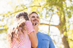 Cute couple kissing in the park Royalty Free Stock Photography