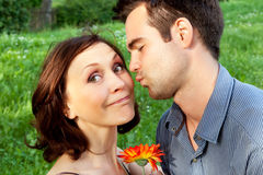 Cute couple kissing in the park Stock Photography