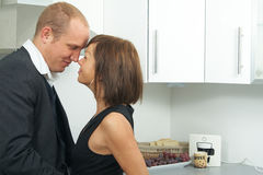 Cute couple in kitchen Stock Photography