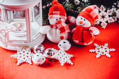 Cute couple of little snowmen is standing near the white fairy lantern Royalty Free Stock Photos