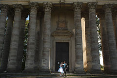 Cute couple look at eath other on background beautiful columns stock photos