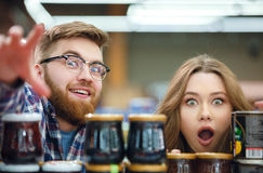 Cute couple looking camera with suprised faces Stock Images