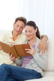 Cute couple looking at a photo album Stock Photography