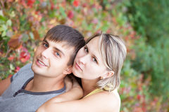 Cute couple in love and autumn landscape Stock Images