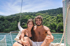 Cute Couple in love sailing through Paraty tropical islands. Bra Stock Image