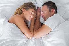 Cute couple lying asleep in bed Royalty Free Stock Images