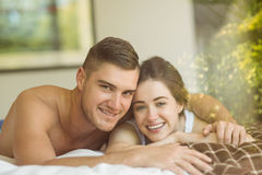 Cute couple lying on bed Royalty Free Stock Photography