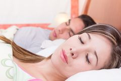 Cute couple lying in bed sleeping Royalty Free Stock Image