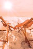 Cute couple lying on deck chairs Royalty Free Stock Photos