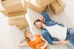 Cute couple lying on floor in their new home Royalty Free Stock Images