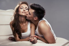 Cute couple lying Stock Images