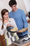 Cute couple making crepes Royalty Free Stock Photo