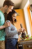 Cute couple making a salad Stock Image