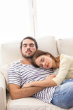 Cute couple napping on couch Royalty Free Stock Photos