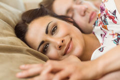 Cute couple napping on couch Stock Photos