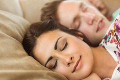 Cute couple napping on couch Stock Image