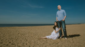 Cute Couple Near the Sea  Family  and Relationship Concept Stock Photos