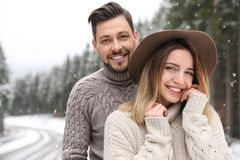 Cute couple outdoors on snowy day. Winter. Vacation royalty free stock photos